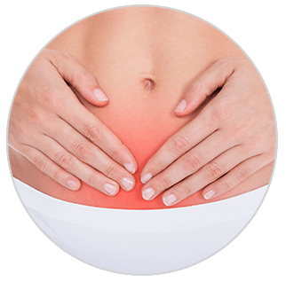 A shot on the lower abdomen area of a woman with her two hands on top of it